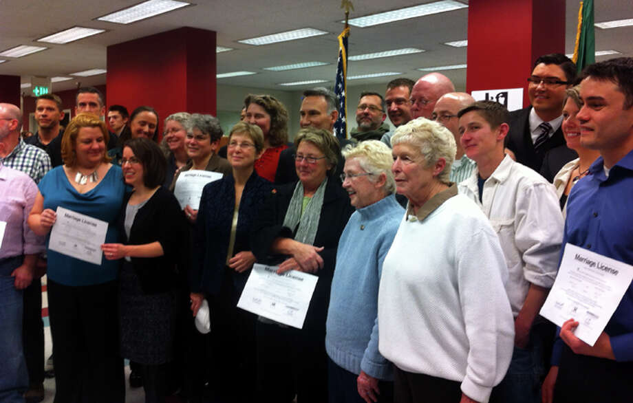 A group photo of the first same-sex couples to receive a marriage license in King County, Dec. 6, 2012. (Casey McNerthney/seattlepi.com)