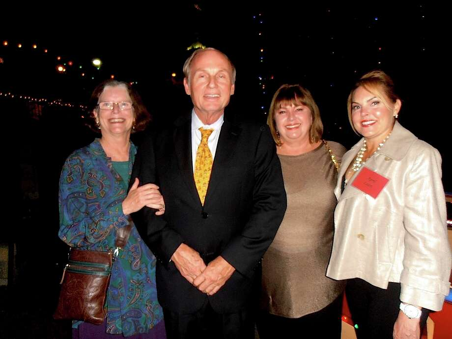 Gayle Spencer, from left, Honorary Consul of Belgium Bob Braubach, Nancy Avellar and April Lazri visit after disembarking from barges at the San Antonio Conservation Society Capital ClubÕs party to view holiday lights. Photo: Nancy Cook-Monroe