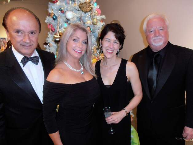 At the Blue Starry Night gala, Humberto Salda–a, from left, Caprice Taylor, new Artpace Executive Director Amada Cruz and Blue Star President Bill Fitzgibbons gather to admire artist-decorated trees. Photo: Nancy Cook-Monroe