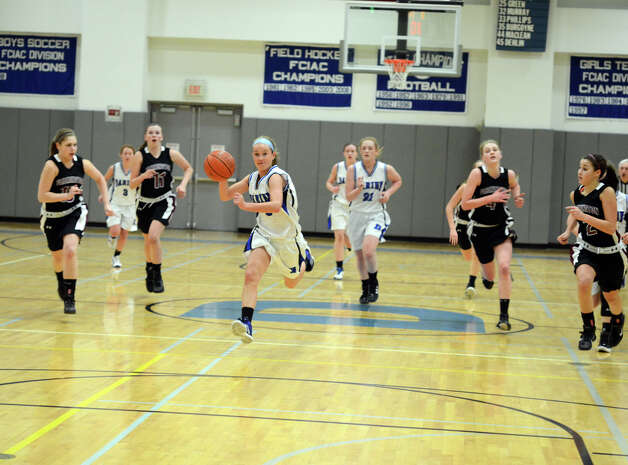 Darien's Emily Stein (5) sprints down the court during the girls basketball game against Farmington at Darien High School on Tuesday, Feb. 28, 2012. Photo: Amy Mortensen
