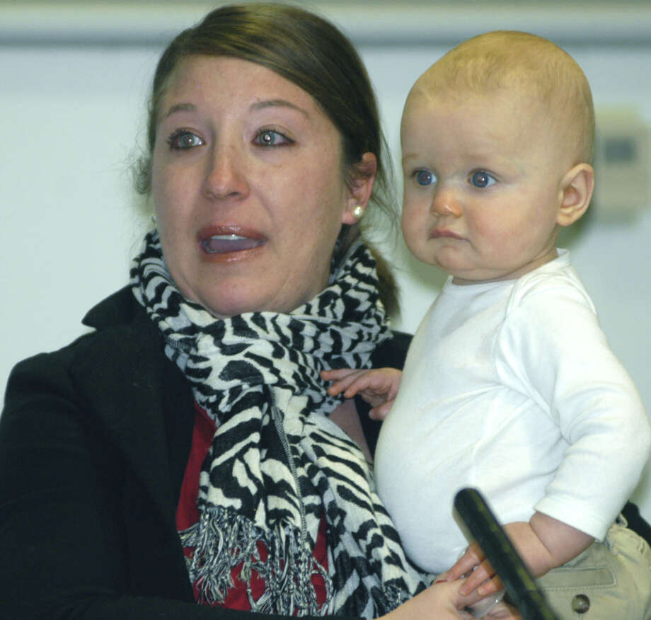 Eight-month-old Liam Burk likely can't figure what the fuss is all about as his mother, Lindsey Burk, delivers an emotional plea to keep the New Milford Hospital birthing center open Tuesday, Dec. 4, 2012 during the state Department of Health's public hearing concerning the New Milford Hospital Family Birthing Center at New Milford Hospital. Photo: Norm Cummings
