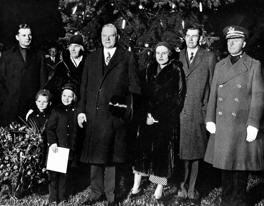 President Herbert Hoover and family pose in front of a Christmas tree in Washington. Photo: Associated Press
