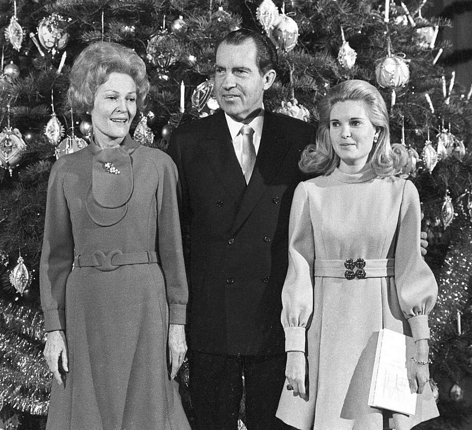 U.S. President Richard Nixon, first lady Pat Nixon and their daughter Tricia stand beside the Christmas tree in the main lobby of the White House on Dec. 21, 1969, following a worship service. Photo: Associated Press / AP1969