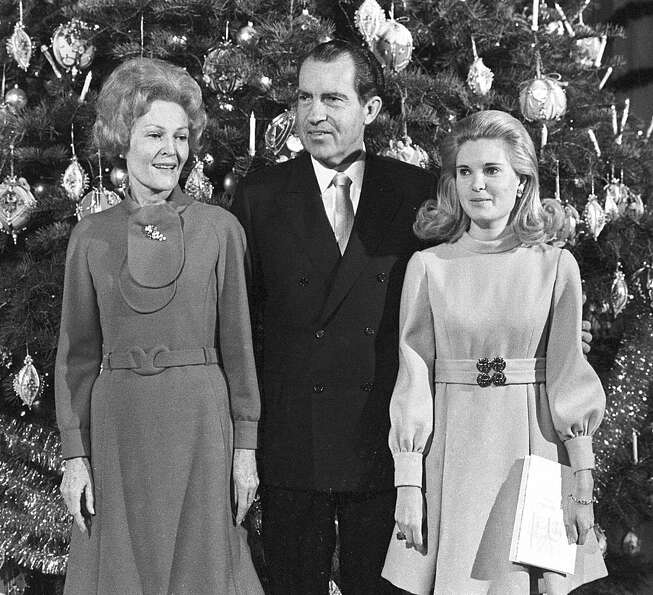 U.S. President Richard Nixon, first lady Pat Nixon and their daughter Tricia stand beside the Christ
