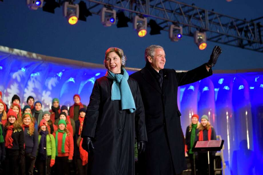 President Bush and first lady Laura Bush arrive to participate in the lighting of the National Christmas Tree and the Pageant of Peace at The Ellipse near the White House in Washington, Thursday, Dec. 6, 2007. Photo: J. Scott Applewhite, Associated Press / AP2007