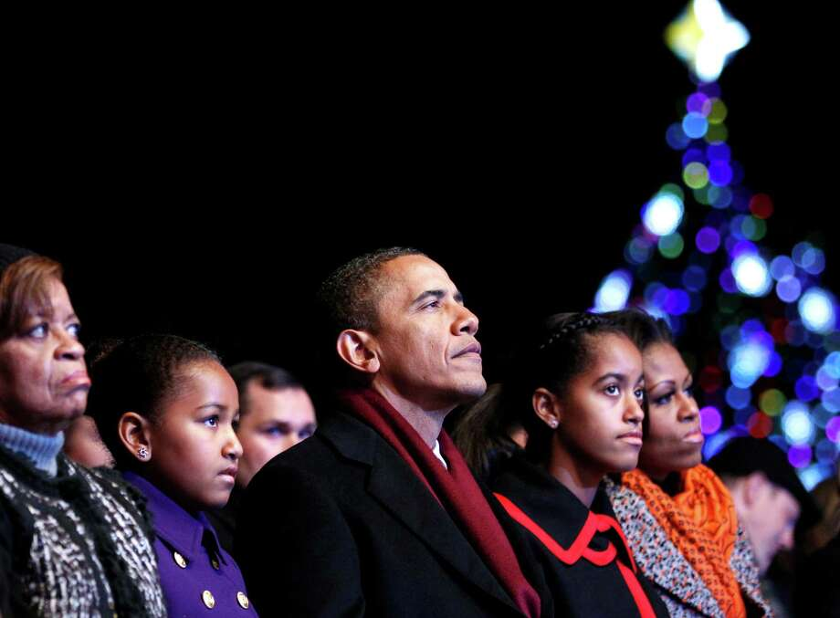 The Obamas are just the last in a long line of presidential families who have lit the National Christmas Tree in Washington, D.C. The annual tradition goes back to Calvin Coolidge in 1923. Photo: Associated Press