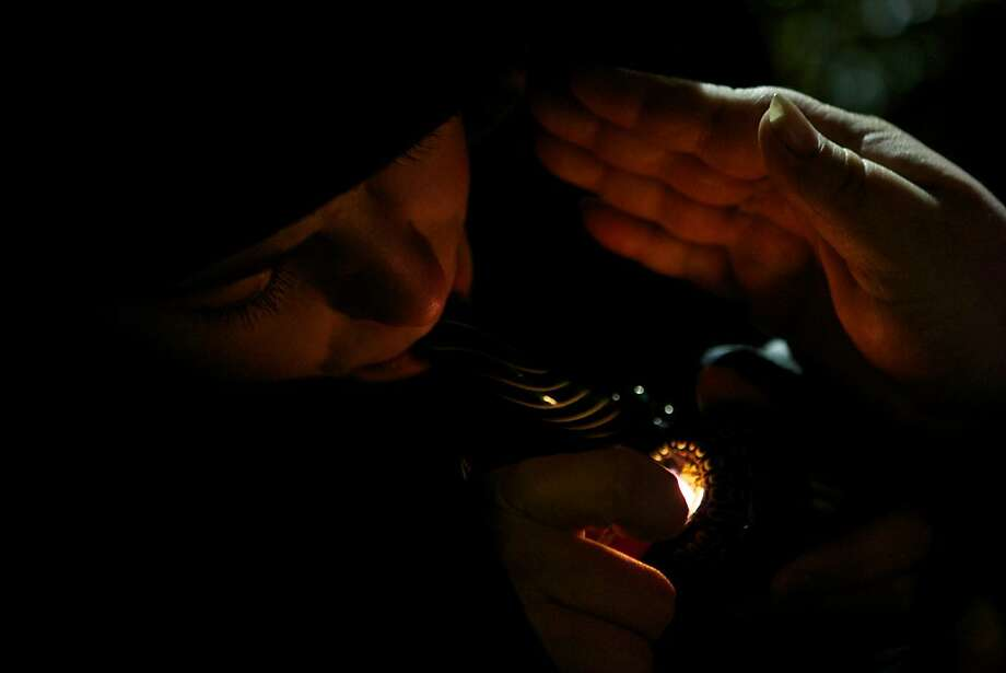 A resident of Tacoma, Washington smokes marijuana shortly before a law legalizing the recreational use of  marijuana took effect on December 5, 2012 in Seattle, Washington.  Voters approved an initiative to decriminalize the recreational use of marijuana making it one of the first states to do so. Photo: Stephen Brashear, Getty Images