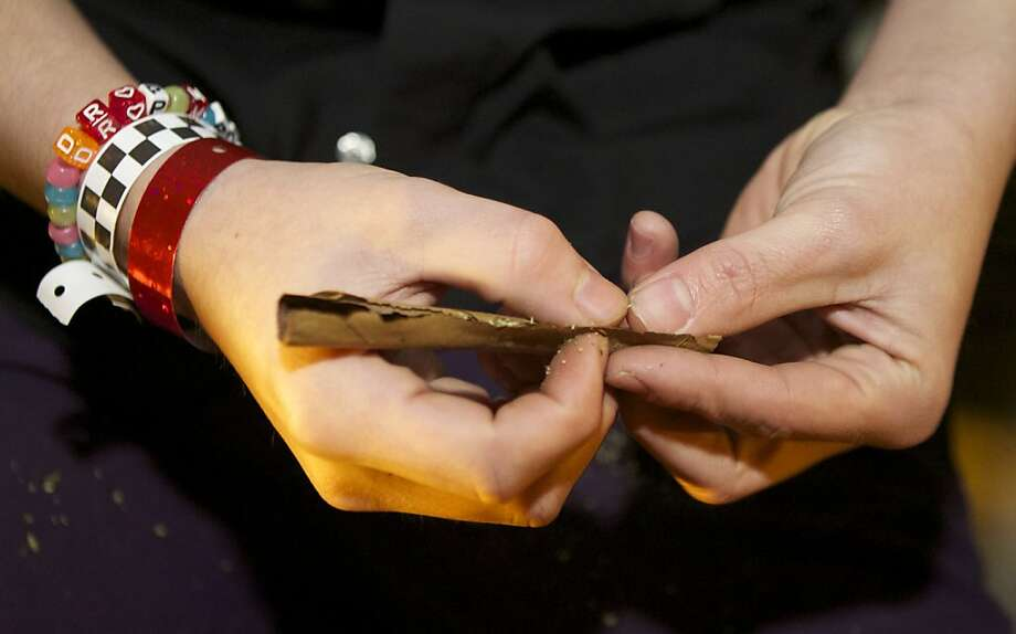 A Tacoma resident rolls a joint shortly after a law legalizing the recreational use of  marijuana took effect on December 6, 2012 in Seattle, Washington.  Voters approved an initiative to decriminalize the recreational use of marijuana making it one of the first states to do so. Photo: Stephen Brashear, Getty Images