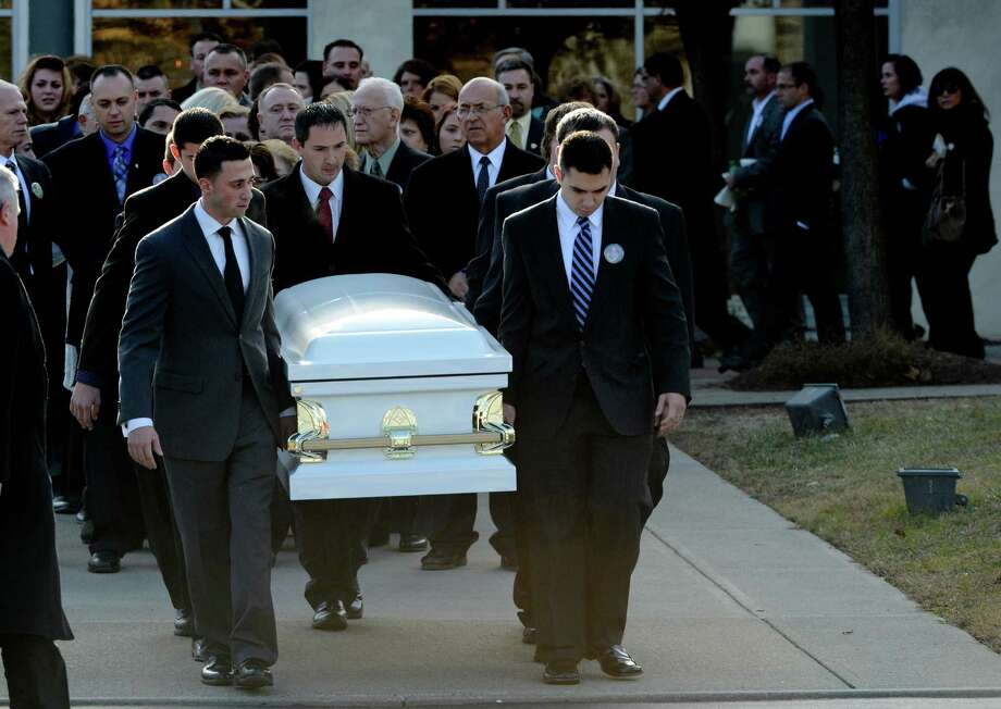 The casket bearing the remains of accident victim Deanna Rivers is moved from St. Edward the Confessor Church in Clifton Park, N.Y. Dec 6, 2012.  (Skip Dickstein/Times Union) Photo: SKIP DICKSTEIN / 00020374A