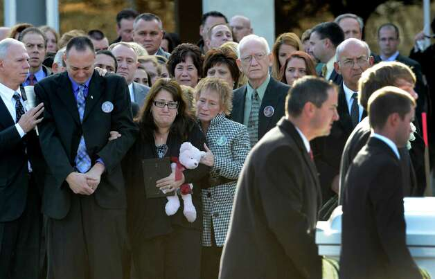 Family members follow the casket bearing the remains of accident victim Deanna Rivers as it is moved from St. Edward the Confessor Church in Clifton Park, N.Y. Dec 6, 2012.  (Skip Dickstein/Times Union) Photo: SKIP DICKSTEIN / 00020374A