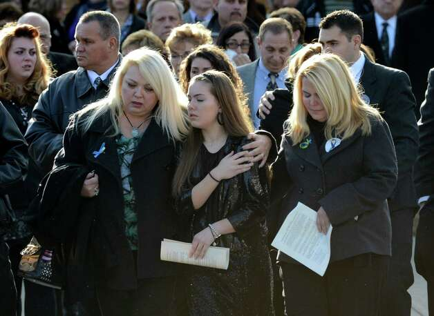 Friends and relatives leave St. Edward the Confessor Church in Clifton Park, N.Y. Dec 6, 2012 after the funeral ceremony for accident victim Deanna Rivers.  (Skip Dickstein/Times Union) Photo: SKIP DICKSTEIN / 00020374A
