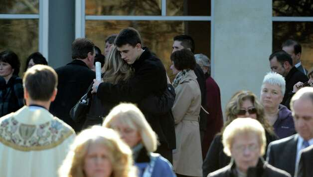 Mourners share their grief outside St. Edward the Confessor Church in Clifton Park, N.Y. Dec 6, 2012 after the funeral ceremony for accident victim Deanna Rivers.  (Skip Dickstein/Times Union) Photo: SKIP DICKSTEIN / 00020374A