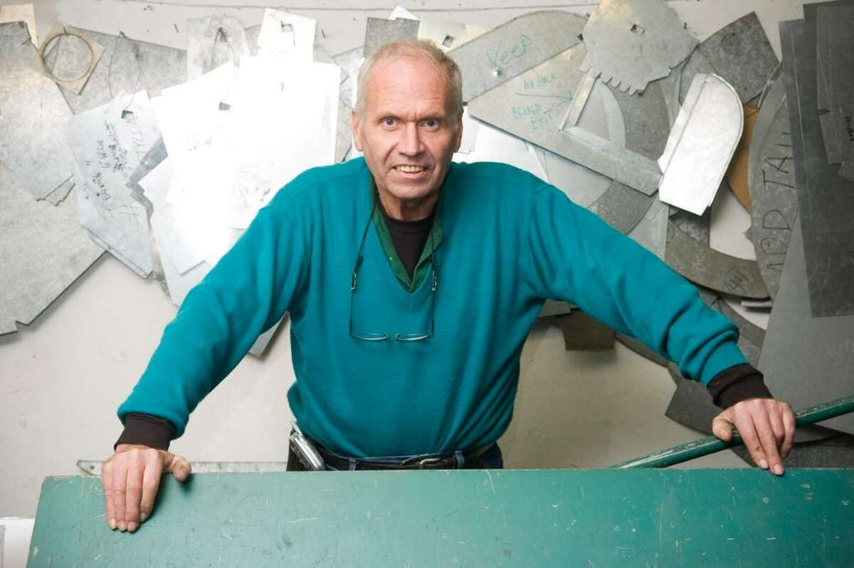 Casey Esposito of Casey's Sheet Metal Service poses in his shop in Norwalk, Conn. on