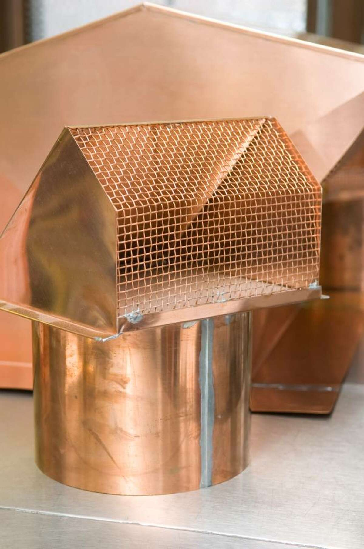 Copper vent and chimney cover at Casey's Sheet Metal Service poses in his shop in Norwalk, Conn. on