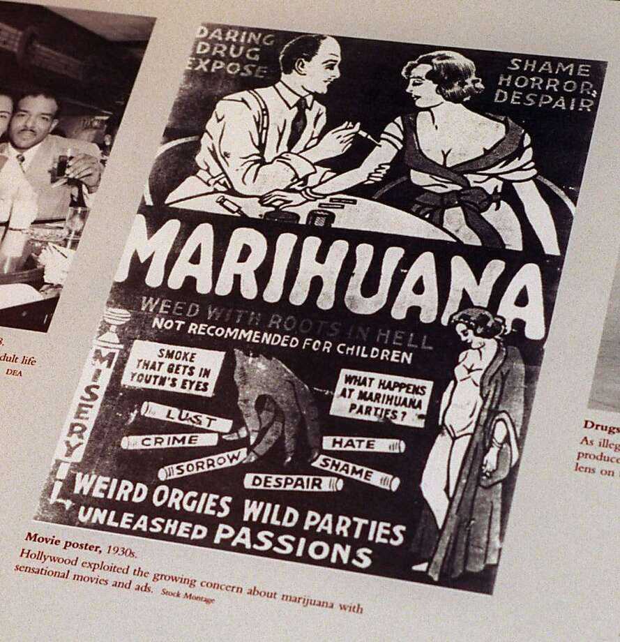 "This undated file photo provided by the Drug Enforcement Administration shows a 1930s anti-marijuana movie poster as part of an exhibit at the DEA Museum and Visitors Center which opened May 10, 1999 in Arlington, Va. After the repeal of alcohol prohibition in 1933, Harry Anslinger, who headed the Federal Bureau of Narcotics, turned his attention to pot. He told of sensational crimes reportedly committed by marijuana addicts. ""No one knows, when he places a marijuana cigarette to his lips, whether he will become a philosopher, a joyous reveler in a musical heaven, a mad insensate, a calm philosopher, or a murderer,"" he wrote in ""Marijuana: Assassin of Youth,"" in 1937. On the occasion of  ""Legalization Day,"" Thursday, Dec. 6, 2012, when Washington's new law takes effect, AP takes a look back at the cultural and legal status of the ""evil weed"" in American history.  Photo: Associated Press"