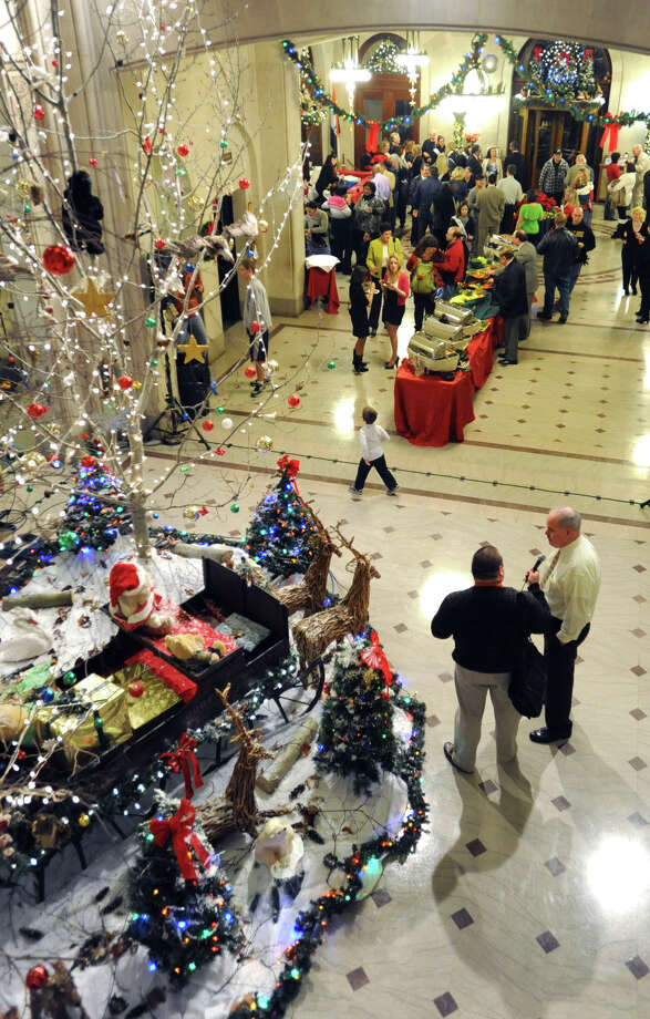 People enjoy food and beverages inside Albany City Hall as part of the city tree lighting ceremony on Thursday, Dec. 8, 2011 in Albany, N.Y.  (Lori Van Buren / Times Union archive) Photo: Lori Van Buren / 10015669A