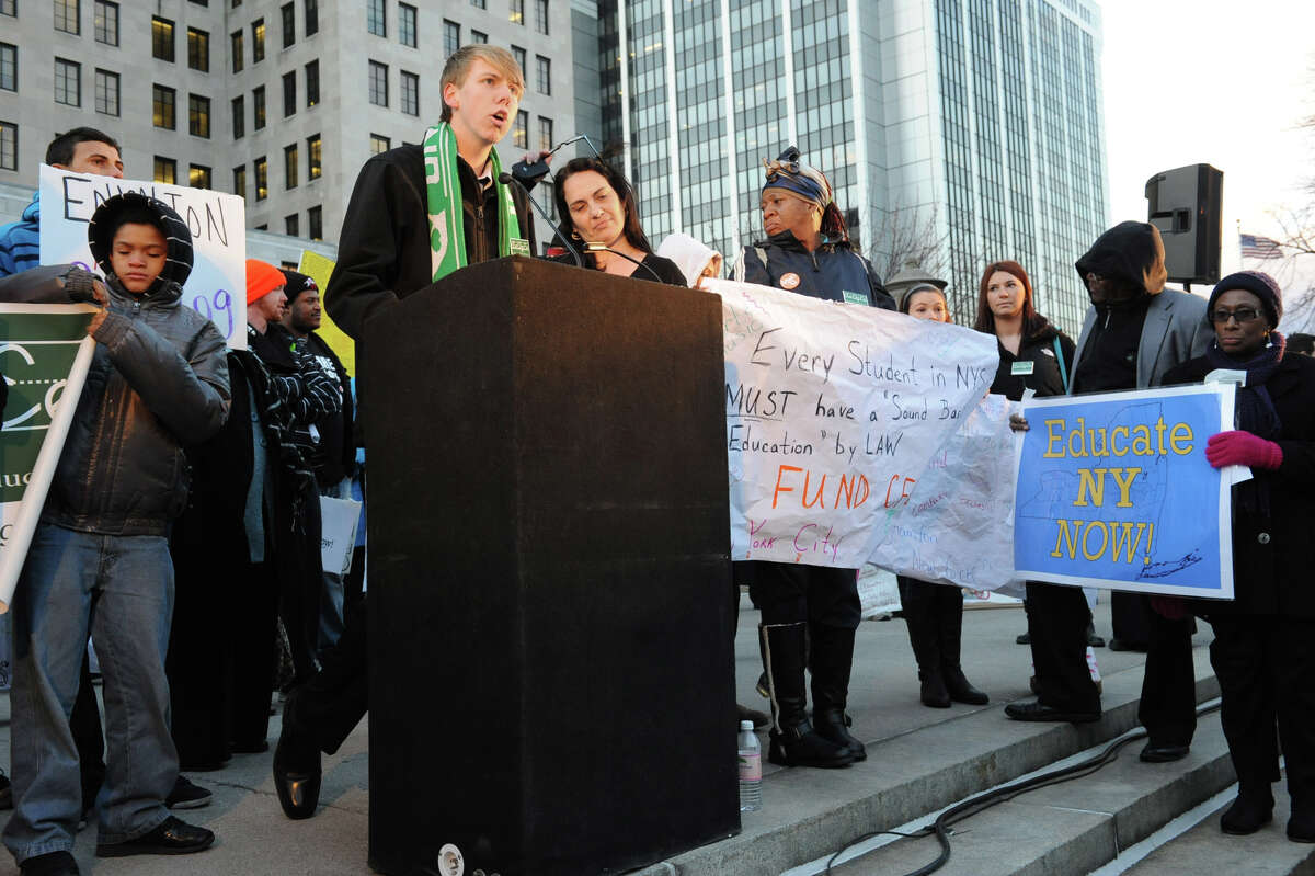 Ryan Carson of Unatego High School speaks in front of hundreds of students, parents, educators & community members from around the state who marched from the NYS Museum to the west park at the Capitol to urge the Governor and the Legislature to keep their commitment to providing a ?sound basic education? and reinvest in New York?s public school children on Wednesday Dec. 5, 2012 in Albany, N.Y. (Lori Van Buren / Times Union)