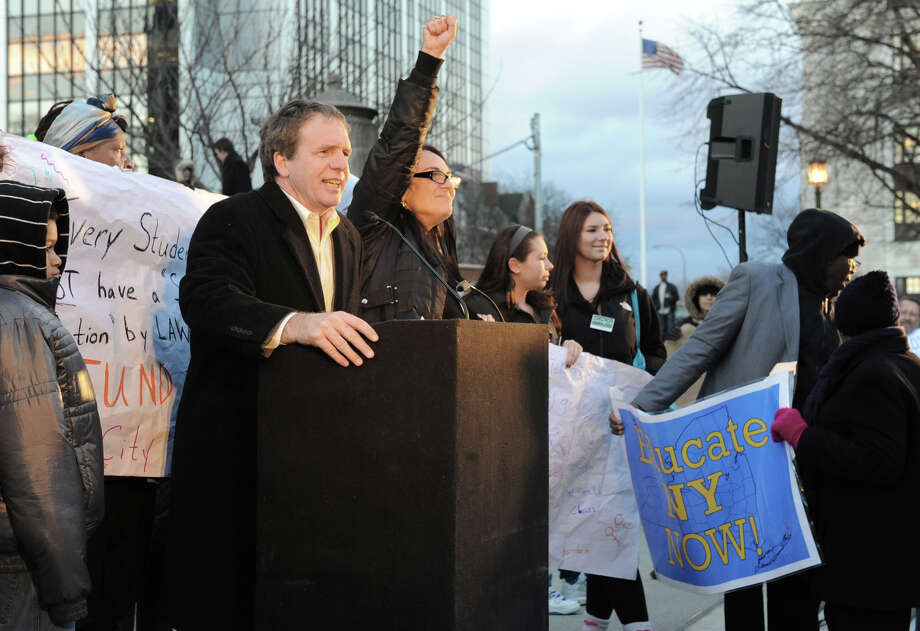 Billy Easton of Alliance for Quality Education speaks in front of hundreds of students, parents, educators & community members from around the state who marched from the NYS Museum to the west park at the Capitol to urge the Governor and the Legislature to keep their commitment to providing a ?sound basic education? and reinvest in New York?s public school children on Wednesday Dec. 5, 2012 in Albany, N.Y.  (Lori Van Buren / Times Union) Photo: Lori Van Buren, Albany Times Union / 00020320A