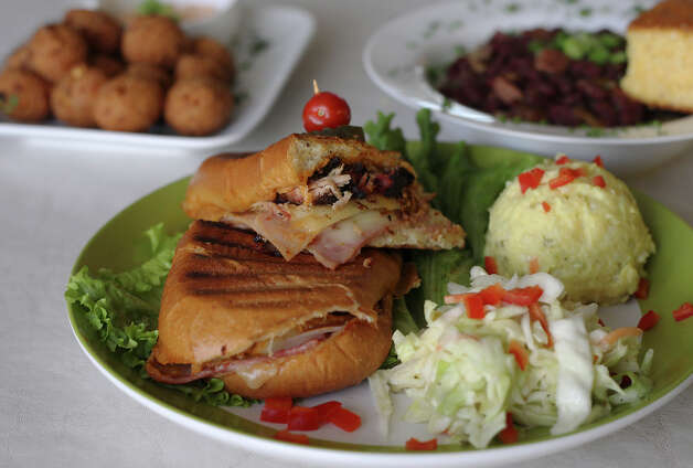 Cajun Cuban sandwich presented by Lenny's BBQ on Wednesday, Dec. 5, 2012. Photo: Kin Man Hui, San Antonio Express-News / ©2012 San Antonio Express-News