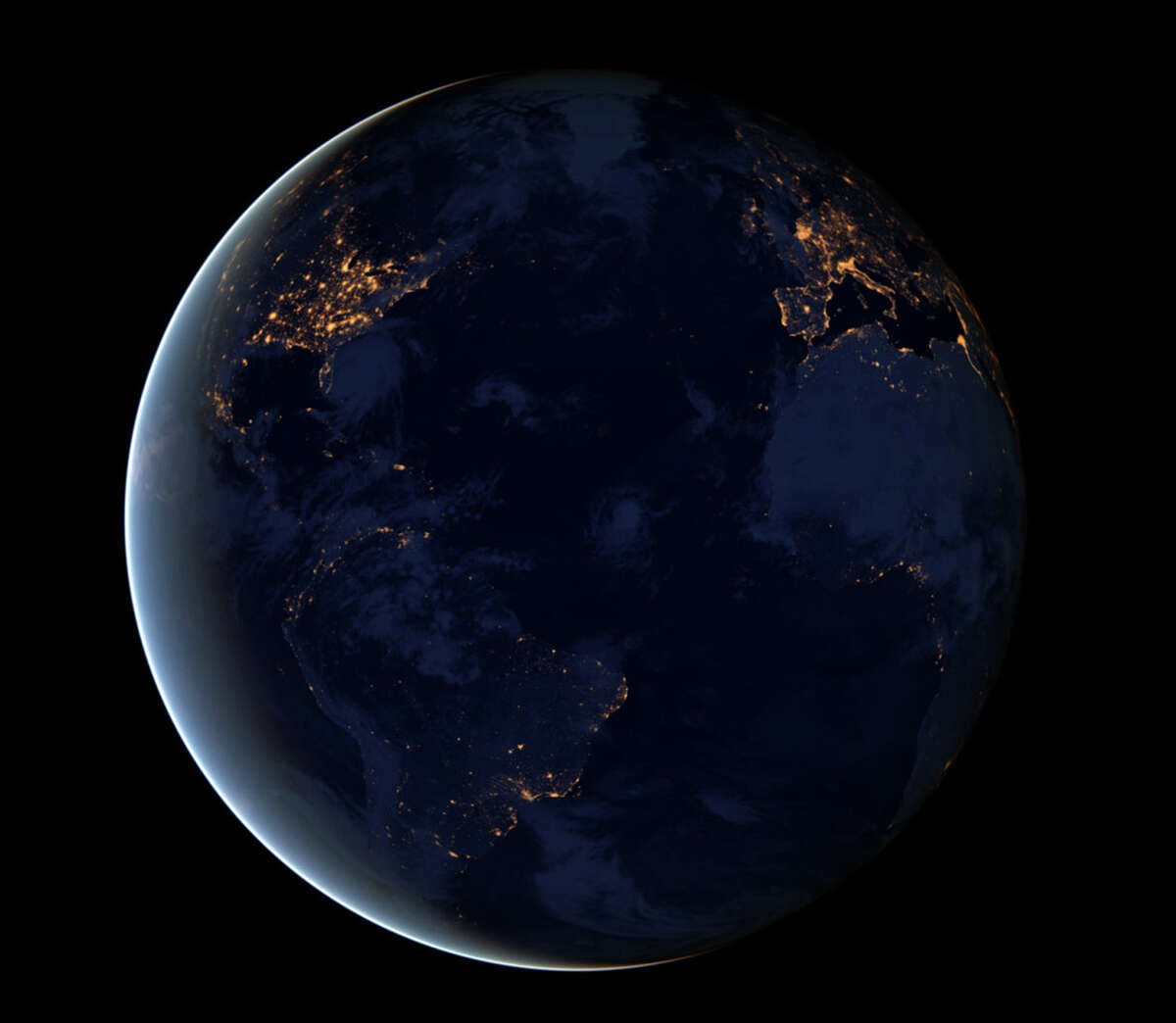 This NASA image obtained December 6, 2012 shows a new global view of Earth�'¢Â€Â™s city lights in a composite assembled from data acquired by the Suomi National Polar-orbiting Partnership (Suomi NPP) satellite. The data was acquired over nine days in April 2012 and thirteen days in October 2012. It took satellite 312 orbits and 2.5 terabytes of data to get a clear shot of every parcel of Earth�'¢Â€Â™s land surface and islands. This new data was then mapped over existing Blue Marble imagery to provide a realistic view of the planet.The image was made possible by the satellite's