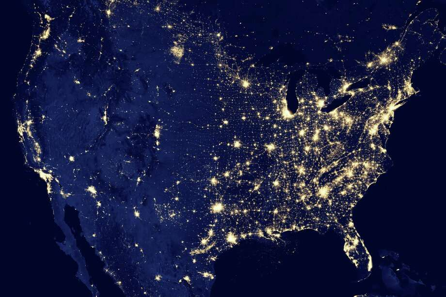 "This NASA  image obtained December 6, 2012 of the continental United States at night is a composite assembled from data acquired by the Suomi NPP satellite in April and October 2012. The image was made possible by the satellite's ""day-night band"" of the Visible Infrared Imaging Radiometer Suite (VIIRS), which detects light in a range of wavelengths from green to near-infrared and uses filtering techniques to observe dim signals such as city lights, gas flares, auroras, wildfires and reflected moonlight. = RESTRICTED TO EDITORIAL USE - MANDATORY CREDIT "" AFP PHOTO / NASA Earth Observatory/NOAA NGDC/"" - NO MARKETING NO ADVERTISING CAMPAIGNS - DISTRIBUTED AS A SERVICE TO CLIENTS =HO/AFP/Getty Images Photo: HO, AFP/Getty Images / AFP"