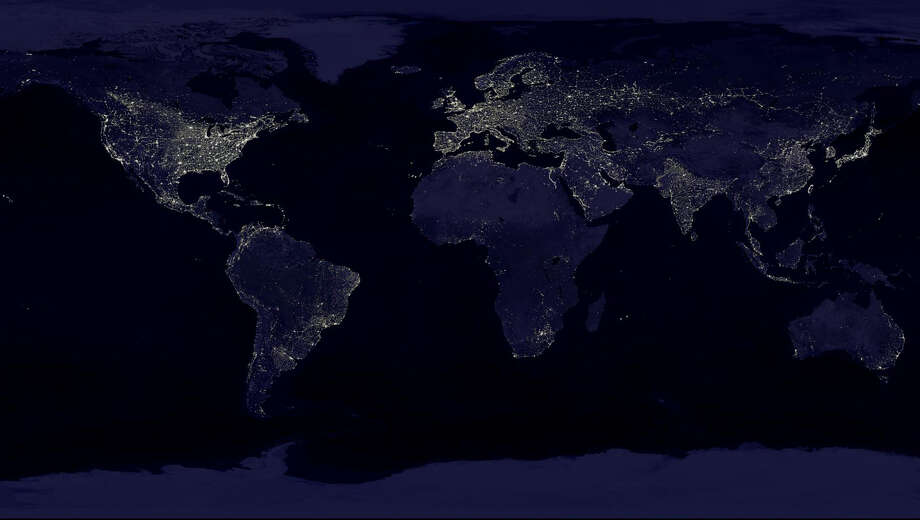 "This NASA image from a composite assembled from data acquired by the Suomi NPP satellite in April and October 2012 shows the earth's city lights at night. It took 312 orbits to get a clear shot of every parcel of Earth's land surface and islands at night.The new data was mapped over existing Blue Marble imagery of Earth to provide a realistic view of the planet. The image was made possible by the new satellite's ""day-night band"" of the Visible Infrared Imaging Radiometer Suite (VIIRS), which detects light in a range of wavelengths from green to near-infrared and uses filtering techniques to observe dim signals such as city lights, gas flares, auroras, wildfires, and reflected moonlight. Photo: AP / NASA"