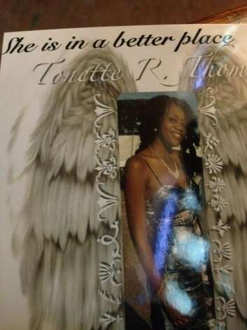 This is the funeral card on display at Tonette Thomas' funeral Thursday in Albany. (PAUL GRONDAHL / TIMES UNION)