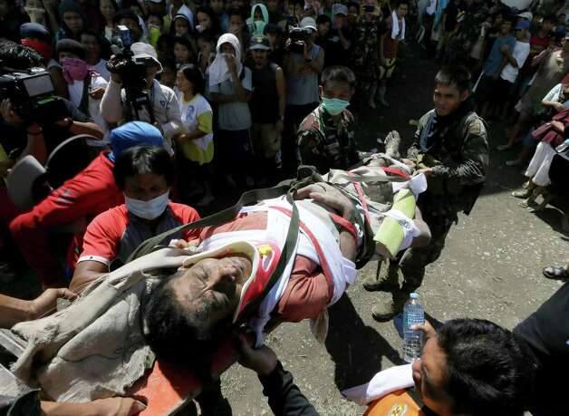 A survivor of Tuesday's devastating typhoon is carried into a makeshift clinic after being rescued Thursday, Dec. 6, 2012, in New Bataan township, Compostela Valley in the southern Philippines.  The powerful typhoon that washed away emergency shelters, a military camp and possibly entire families in the southern Philippines has killed hundreds of people with nearly 400 missing, authorities said Thursday. Photo: Bullit Marquez, AP / AP