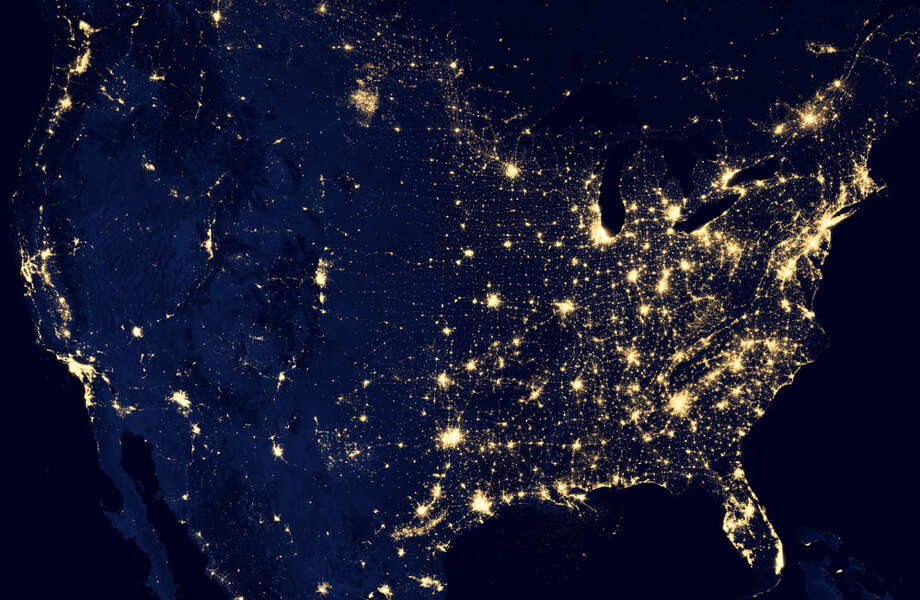 "This NASA image from a composite assembled from data acquired by the Suomi NPP satellite in April and October 2012 shows the United States at night The image was made possible by the new satellite's ""day-night band"" of the Visible Infrared Imaging Radiometer Suite (VIIRS), which detects light in a range of wavelengths from green to near-infrared and uses filtering techniques to observe dim signals such as city lights, gas flares, auroras, wildfires, and reflected moonlight. Photo: Ap"