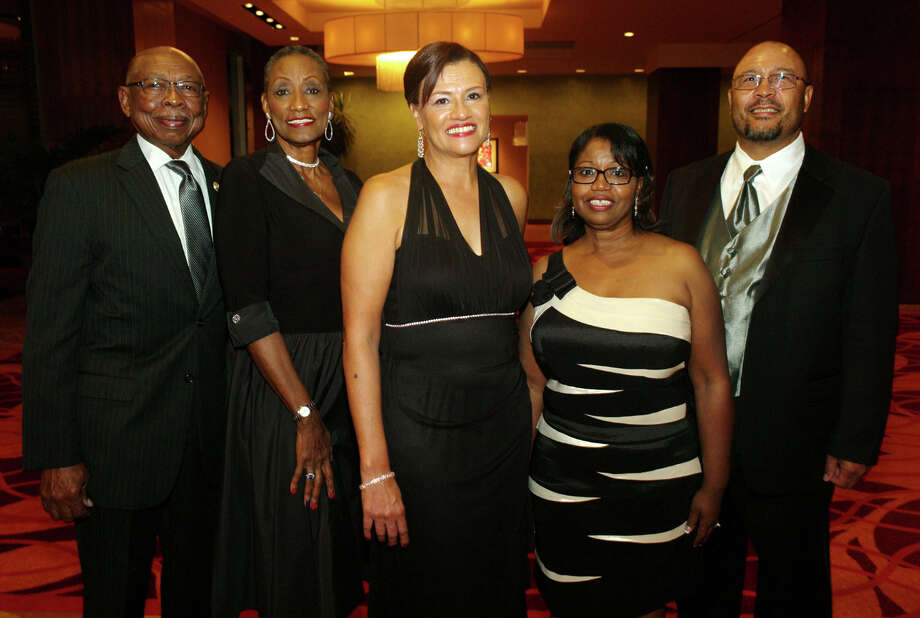 OTS/HEIDBRINK - Guests/Spouses Oliver Hill, from left Minnie Hill, board member Theresa Britts, members/spouses Narcissa Mooney and Don Mooney gather at the Alamo City Black Chamber of Commerce gala at the Grand Hyatt Hotel on 11/30/2012. This is #2 of 2 photos. names checked photo by leland a. outz Photo: LELAND A. OUTZ, SPECIAL TO THE EXPRESS-NEWS / SAN ANTONIO EXPRESS-NEWS
