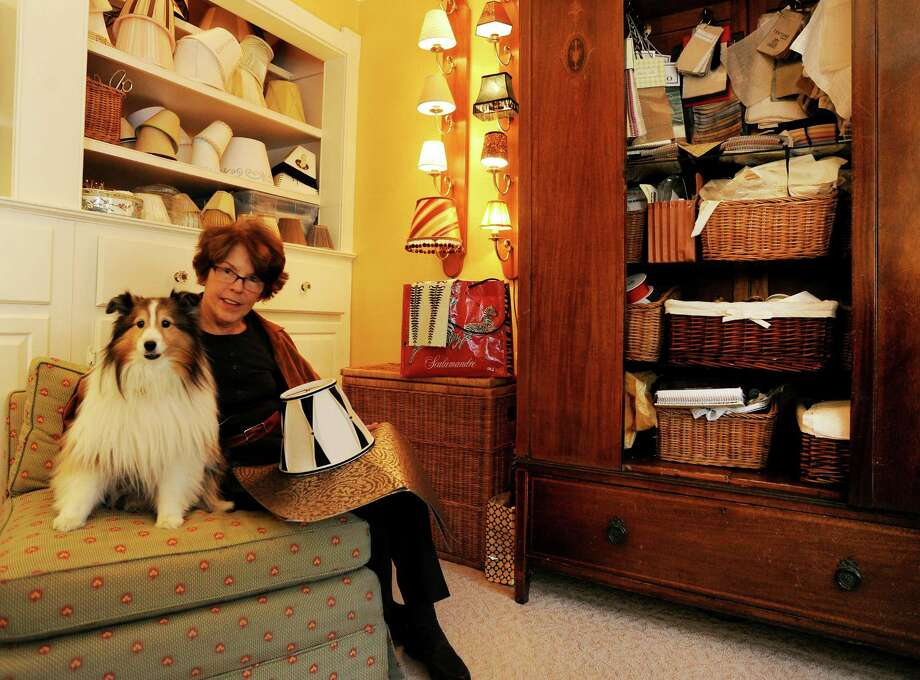 BB Custom Lampshades owner Cynthia Beebe poses with her Sheltie, Lily, in her Westport, Conn. showroom on Thursday, Dec. 6, 2012. Beebe works with professional designers creating and making custom lampshades for high-end homes. Photo: Cathy Zuraw / Connecticut Post