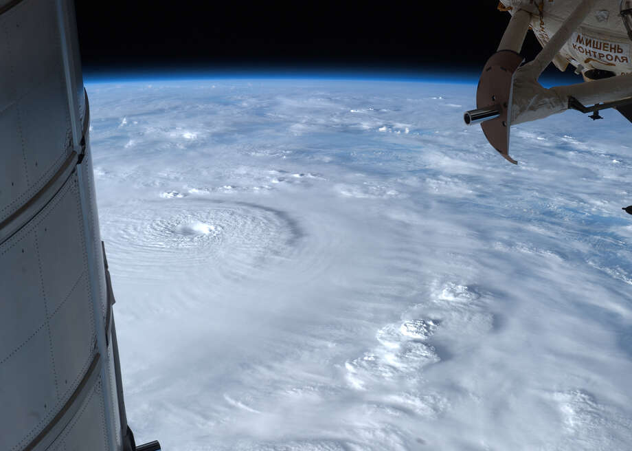 "This NASA still image released December 4, 2012 of Super Typhoon Bopha was taken by Expedition 34 Commander Kevin Ford on December 2, 2012 from the International Space Station, as the storm bore down on the Philippines with winds of 130 miles per hour (210 kilometers).  Parts of the orbital outpost are seen in the picture -- the Permanent Multipurpose Module on the left, and Mini-Research Module 1 on the right. Parts of the orbital outpost are seen in the picture -- the Permanent Multipurpose Module on the left, and Mini-Research Module 1 on the right.  The typhoon slammed into the southern Philippines Tuesday, setting off a mudslide that killed 44 people, tearing up trees, causing floods and forcing thousands to flee their homes to emergency shelters. = RESTRICTED TO EDITORIAL USE - MANDATORY CREDIT "" AFP PHOTO / NASA/"" - NO MARKETING NO ADVERTISING CAMPAIGNS - DISTRIBUTED AS A SERVICE TO CLIENTS =HO/AFP/Getty Images Photo: HO, AFP/Getty Images / AFP"