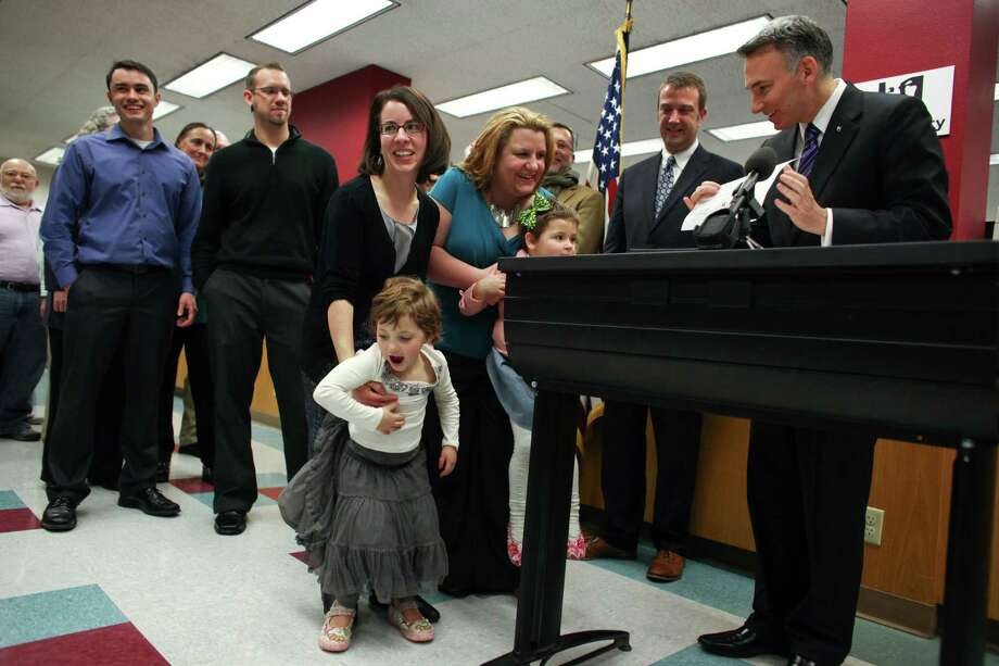 Parents Amanda Beane and Anne Bryson-Beane are given their marriage license by King County Executive Dow Constantine as the couple is among the first to get the document at the King County Administration Building on Wednesday, December 5, 2012. Photo: JOSHUA TRUJILLO / SEATTLEPI.COM
