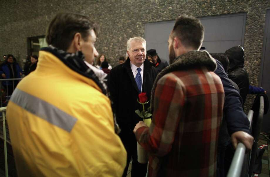 State Senator Ed Murray greets same-sex couples as they wait to get marriage licenses before midnight, outside of the King County Administration Building. Photo: JOSHUA TRUJILLO / SEATTLEPI.COM
