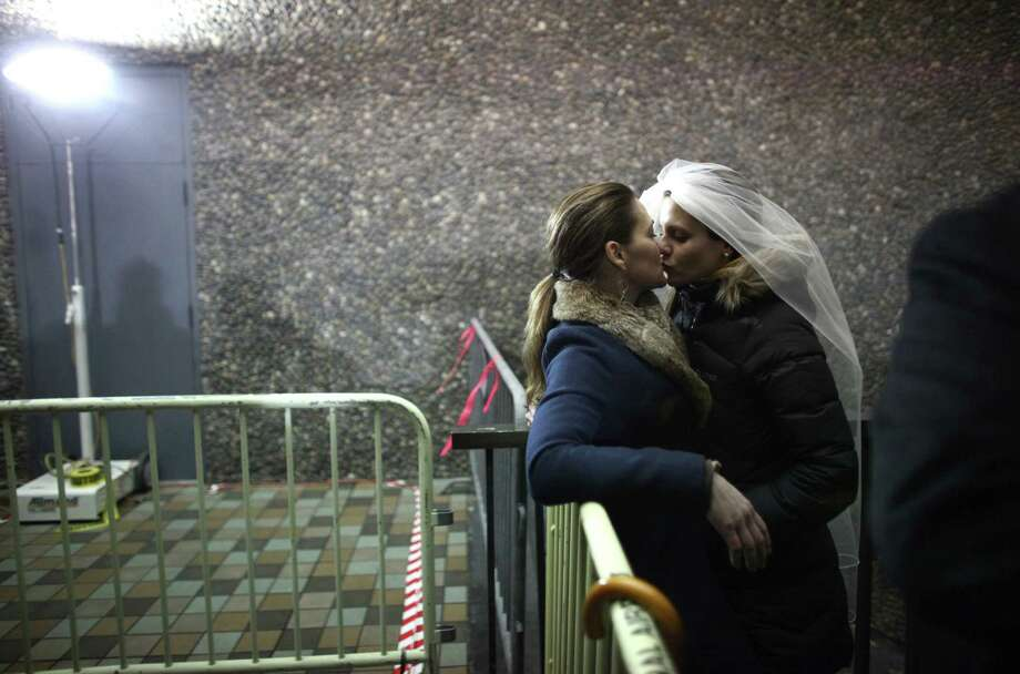Jeri Andrews, left, and her partner of five years Amy Andrews share a moment as same-sex couples wait in line outside of the King County Administration Building. Photo: JOSHUA TRUJILLO / SEATTLEPI.COM