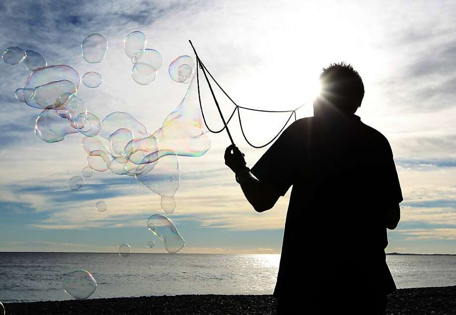 Sudsy spectacles:A man creates soap bubbles on the beach in Nice. Photo: Jean Christophe Magnenet, AFP/Getty Images