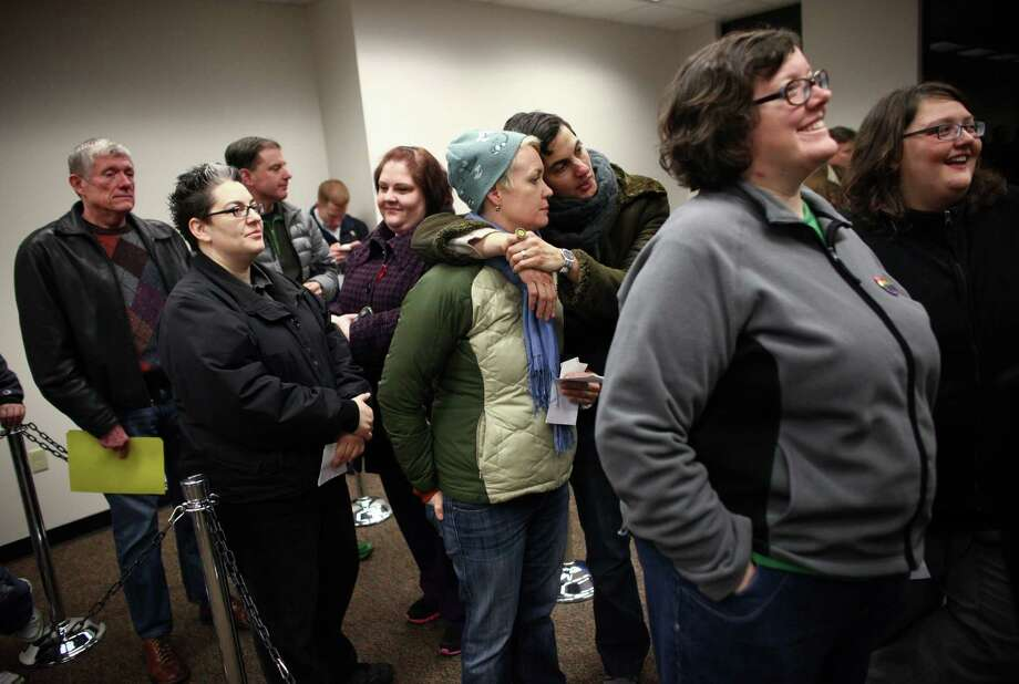 Same-sex couples wait for marriage licenses at the King County Administration Building. Photo: JOSHUA TRUJILLO / SEATTLEPI.COM