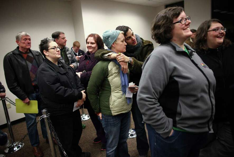 Same-sex couples wait for marriage licenses at the King County Administration Building.