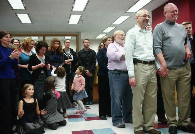 Couples wait in line for their marriage licenses at the King County Administration Building on Wednesday, December 5, 2012. Photo: JOSHUA TRUJILLO / SEATTLEPI.COM