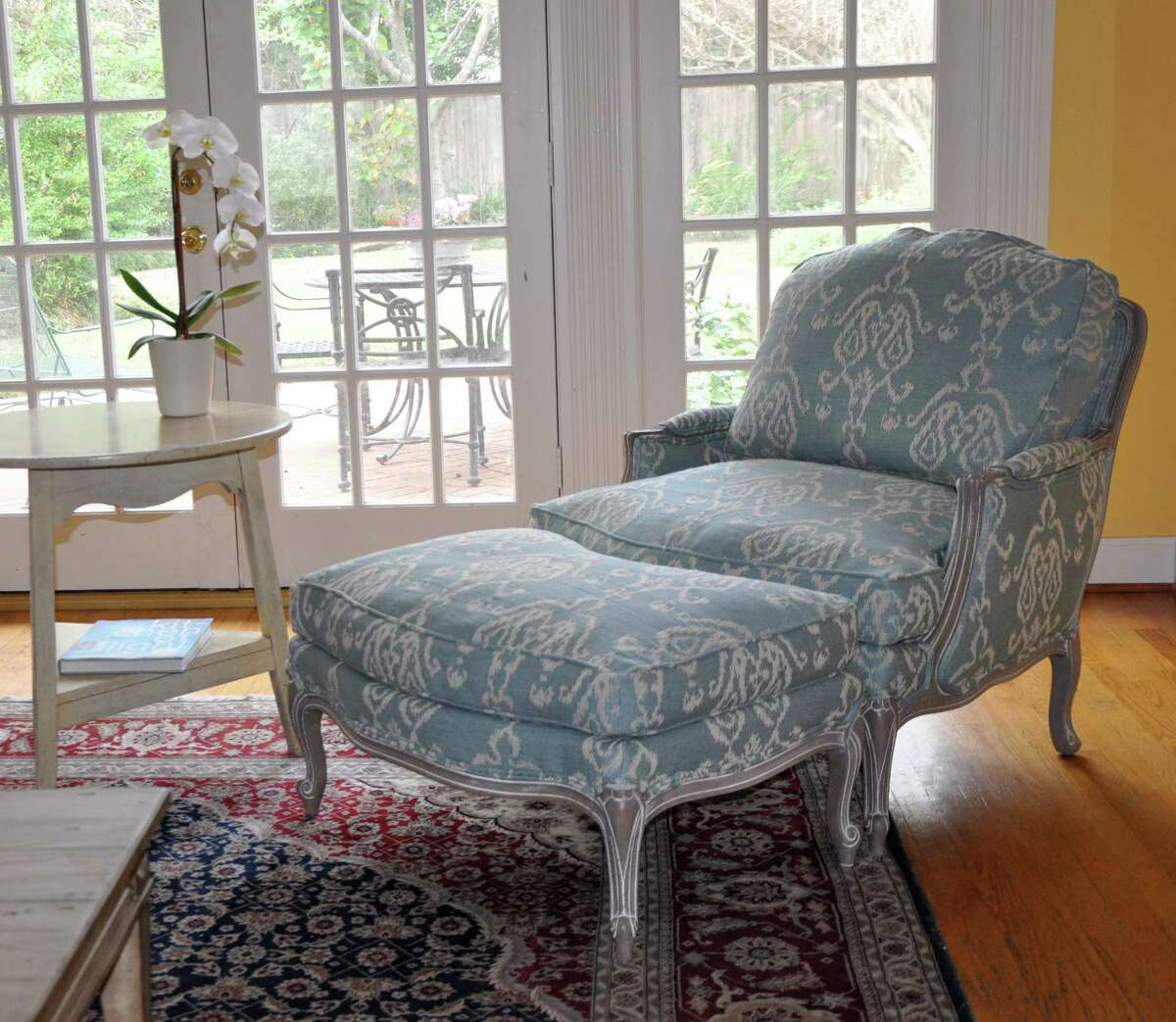 Prices for the Versailles chair start at $1359; the ottoman starts at $689, at Ethan Allen stores.