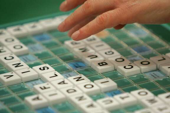 A competitor takes part in the World Scrabble Championships in London November 17, 2005. The championships have taken place every two years since 1991, with participants from many nations playing the board game against each other. REUTERS/Toby Melville