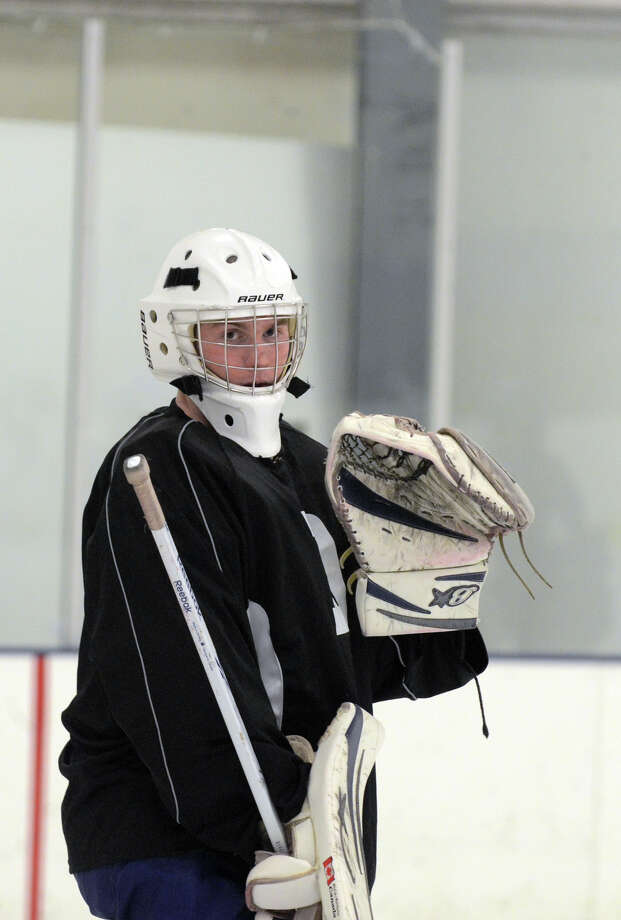 Darien's Christian Miller stands in goal during Darien High School boys hockey practice at the Stamford Twin Rinks on Wednesday, Dec. 5, 2012. Photo: Amy Mortensen / Connecticut Post Freelance