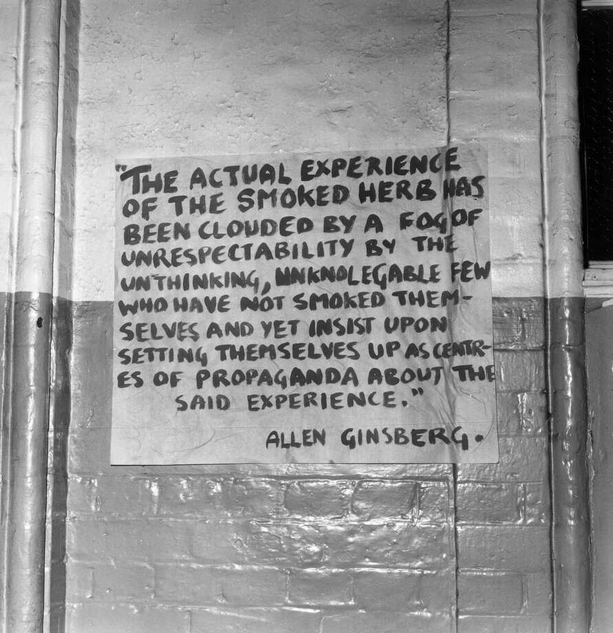 A poster with a quotation in favor of marijuana use by poet Allen Ginsberg hangs on a wall on Sept. 25, 1969. Photo: Sydney O'Meara, Getty Images / Hulton Archive