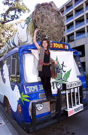 "Mother-of-five Sonia Webb campaigns for more relaxed drug laws on the ""Cannabus"" carrying a 12-metre-long replica of a marijuana joint outside the New South Wales State Parliament at the start of the Drug Summit in Sydney on May 17, 1999.  Photo: TORSTEN BLACKWOOD, AFP/Getty Images / AFP"