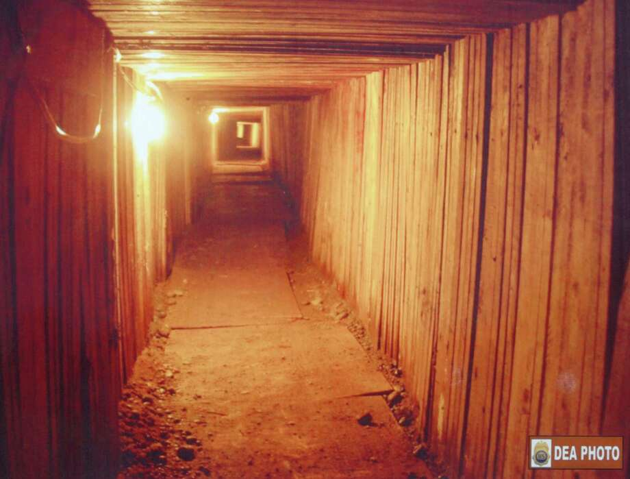 "In this handout from Drug Enforcement Administration, cross-border tunnel  between  between the Lynden, WA  and Aldergrove, B.C., Canada, is seen July 21, 2005. So-called ""B.C. Bud"" is commonly smuggled across the border. Photo: Handout, Getty Images / 2005 DEA"