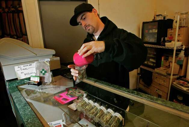 Alternative Herbal Health Services worker Jason Beck packages medical marijuana April 24, 2006 in San Francisco, after the Food and Drug Administration issued a statement declaring that there is no scientific evidence supporting use of the drug for medical treatment. Photo: Justin Sullivan, Getty Images / 2006 Getty Images