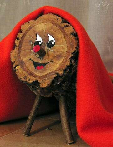 "Spain, Catolonia: Caga Tió - 'Christmas Crapper' The tió is a tree trunk with a hole inside, little legs and a face painted on it. Each night, the children give the tió a little bit to ""eat"" and cover him with a little blanket so that he won't be cold at night. On Christmas day they put the tió partly into the fireplace and order it to poop. To make him poop, the children beat him with sticks, while singing various songs of Tió de Nadal. Out comes candies and nuts for everyone to share.  (Tio de Nadal From English wikipedia) Photo: Ti  De Nadal, Http://en.wikipedia.org/wiki/Ima"