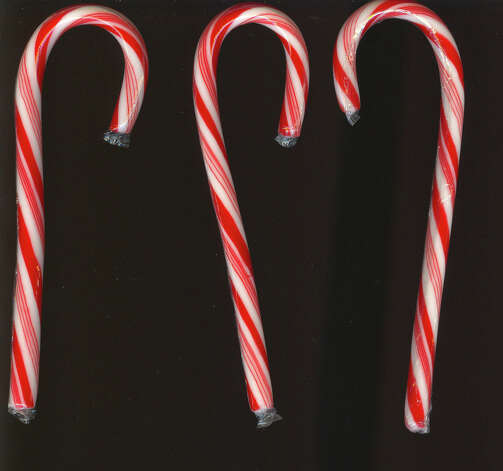 12. Candy cane- 1 1/2 oz. vodka- 1/2 oz. peppermint schnapps- 1/2 oz. white creme de cacao- crushed candy caneAnother easy one -- unless you have trouble crushing a candy cane. First things first: Wet the edge of a martini glass and rim it with your crushed candy cane. Then add the vodka, peppermint schnapps and creme de cacao to a cocktail shaker with ice. Shake it all up then strain it into your candy-rimmed martini glass. If you want, garnish it with a miniature candy cane. Beware -- you've gotta like peppermint for this minty-fresh cocktail.Recipe via Zimbio.com Photo: Mikereichold / Mikereichold (Wikimedia Commons)