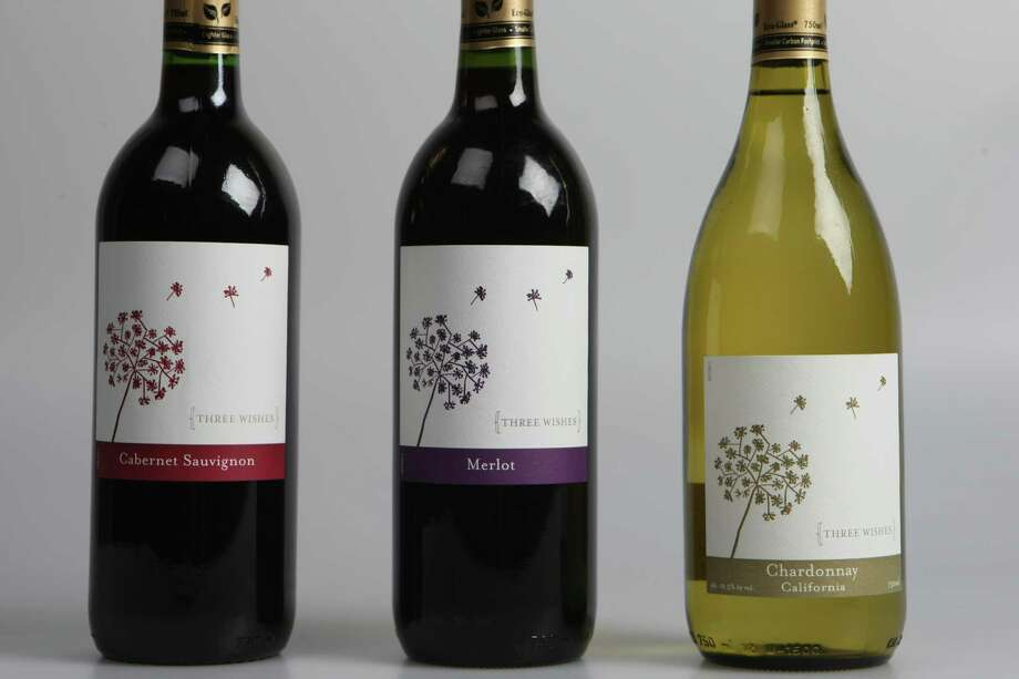 Value wines from Whole Foods. Photo: Helen L. Montoya, San Antonio Express-News / ©SAN ANTONIO EXPRESS-NEWS