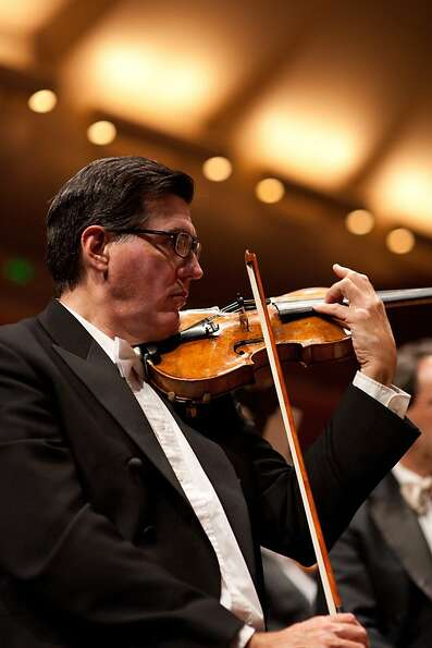 Violinist and composer Mark Volkert has been with the Symphony for 40 years.